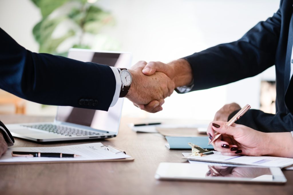 business lawyer shaking hands with client